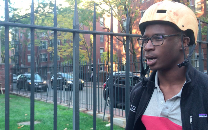 Youssouf Camara explains his experiences biking around Harvard University on Oct. 20, 2017, in Cambridge, Mass. Camara has been pleased with the community's transition away from driving, and hoped that fewer drivers will make the roads safer for bikers. Photo: Remi Duhé / BU News Service