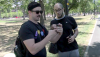 Cambridge residents David Tulis and Jose Negon tackle Pokemon-catching strategies in Cambridge Common and Harvard Square.